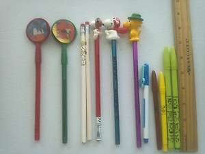 12 USED RANDOM SNOOPY/PEANUTS GANG PENCILS/PENS FLYING ACE/WOODSTOCK